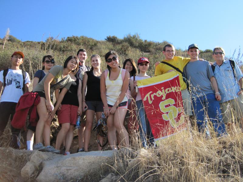 Fight on and Hike on USC! Students with Trailmaster John McKinney (far R) show the school colors atop Echo Mountain.