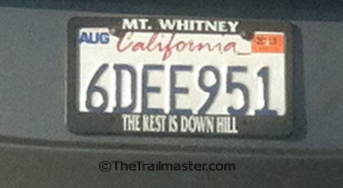 """Hikers can even buy a souvenir license plate frame to remember the trek: """"Mt. Whitney, The Rest is Down Hill."""""""