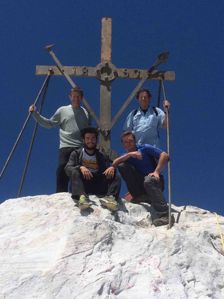 Atop Athos is an iron cross, where we four pilgrims are all smiles after our long climb: (L-R) Spiro Deligiannis, John McKinney, Zachary Deligiannis and Daniel McKinney.