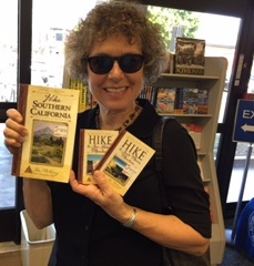 Auto Club member and avid hiker Marianne Wallace with The Trailmaster books available at the Arcadia office.