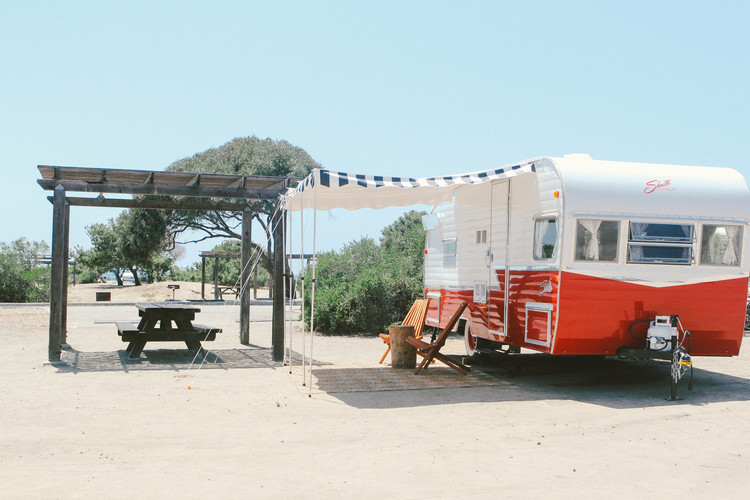 Overnight in 1960s' style with a vintage trailer from The Holidays at San Clemente State Beach.