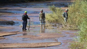 After the recent flash floods in Utah, a Search and Rescue Team looks for victims. (photo AP/Michael Chow)