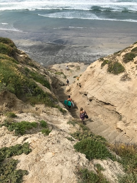 Descend a steep trail from Torrey Pines Glider Port to famed Blacks Beach
